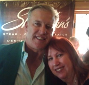 John Elway poses with On The Town columnist Penny Parker at Thursday's 