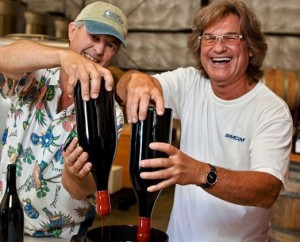 Kurt Russell dips the signature wax top on one of the bottle to his pinot.