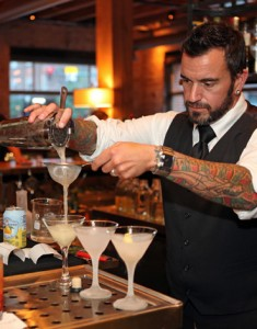 A mixologist pours on of the famed drinks at The Squeaky Bean. (Photo by Adam Larkey)
