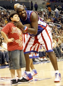 Big Easy and the Harlem Globetrotters are coming to Pepsi Center with some new 'rules.' In this photo, Big Easy clowns with 'Modern Family' actor Rico Rodriguez. Big Easy and his fellow Globetrotter, Flight Time Lang, competed on the CBS reality series, 'The Amazing Race.' (Harlem Globetrotters photo)