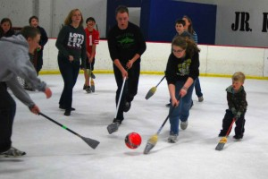 Broomball is a sport played with an actual broom that is taped up and ball smaller than a soccer ball. Some players use specially-made sticks.