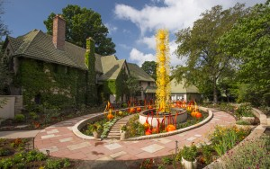 "Dale Chihuly, ""Saffron Tower"", 2008 with ""Cattails"" and ""Niijima Floats"", 2014. Denver Botanic Gardens"